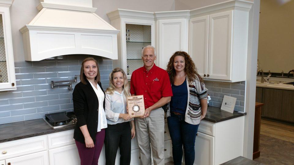 Bertch Cabinet Representative Mandy Manning presents Marcus Lumbers Kitchen and Bath Designers a National Award. (LtoR: Miranda Wallen, Mandy Manning, Jim Leavitt, Angie Brownmiller)